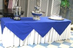 King Rental: Long table with blue linen on white linen