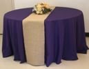 King Rental: Round table with burlap on purple linen