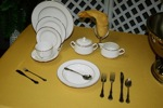 King Rental: Yellow table with china